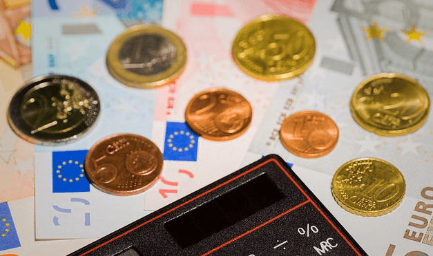 Money transfer image of a calculator and some euros