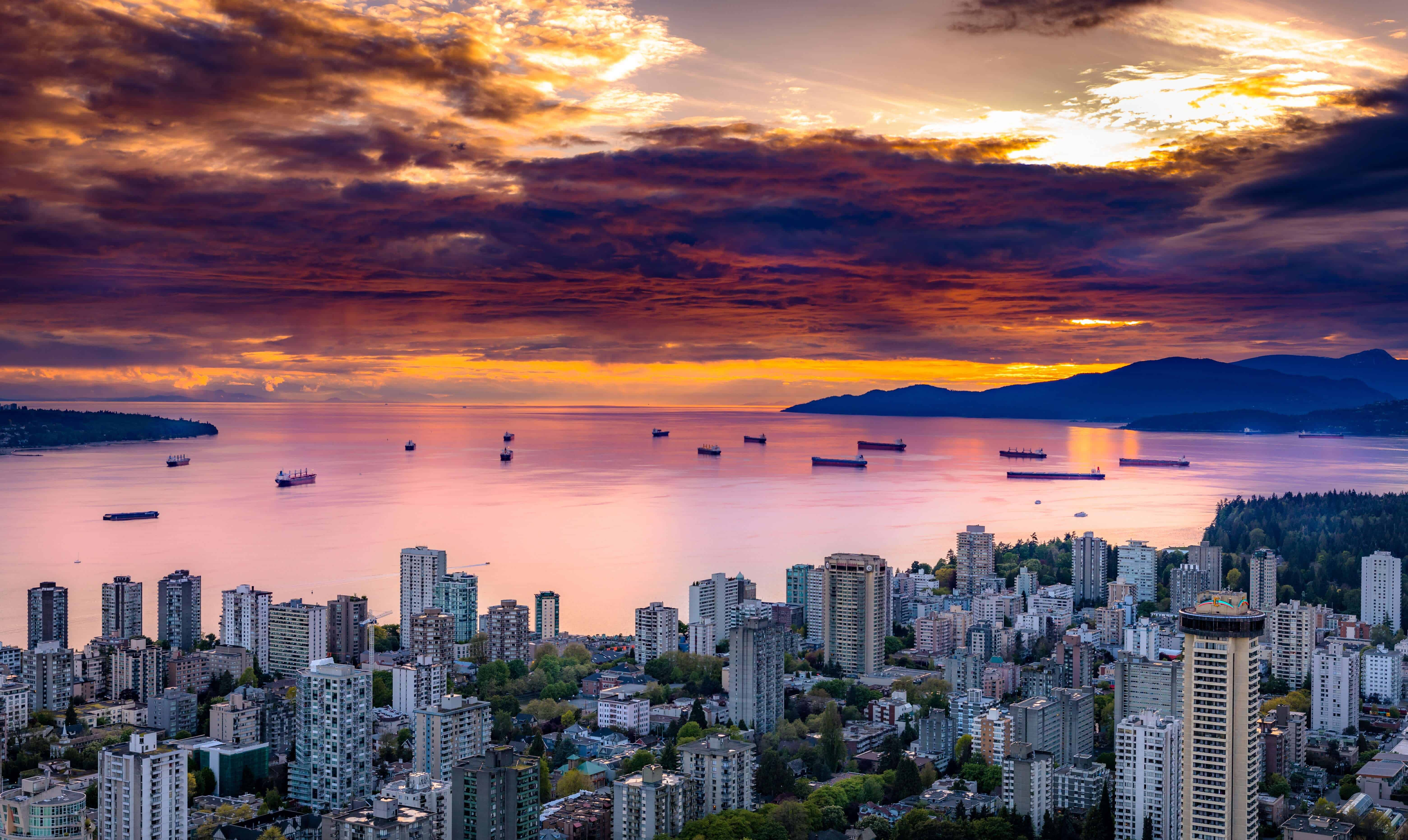View overlooking Vancouver from a skyscrapper at sunset.